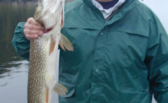 Fishing is a family affair. This is my son John with a northern pike.